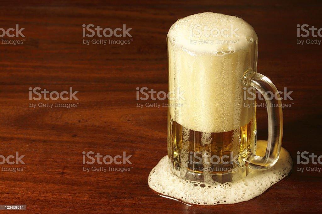 Frothy mug of beer royalty-free stock photo