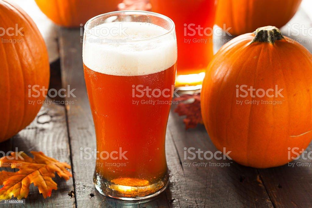 Frothy Orange Pumpkin Ale stock photo