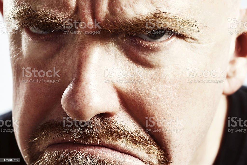 Frowning angrily, this mature man glares at camera royalty-free stock photo