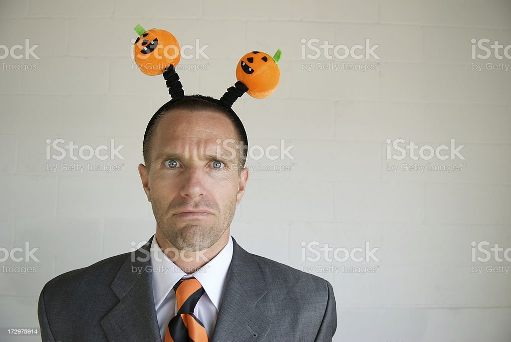 Frowning Businessman Wears Halloween Headgear royalty-free stock photo