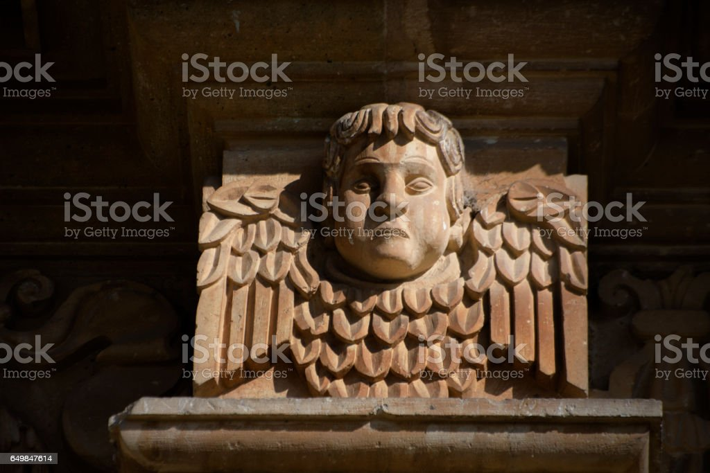 frowning cherub stock photo