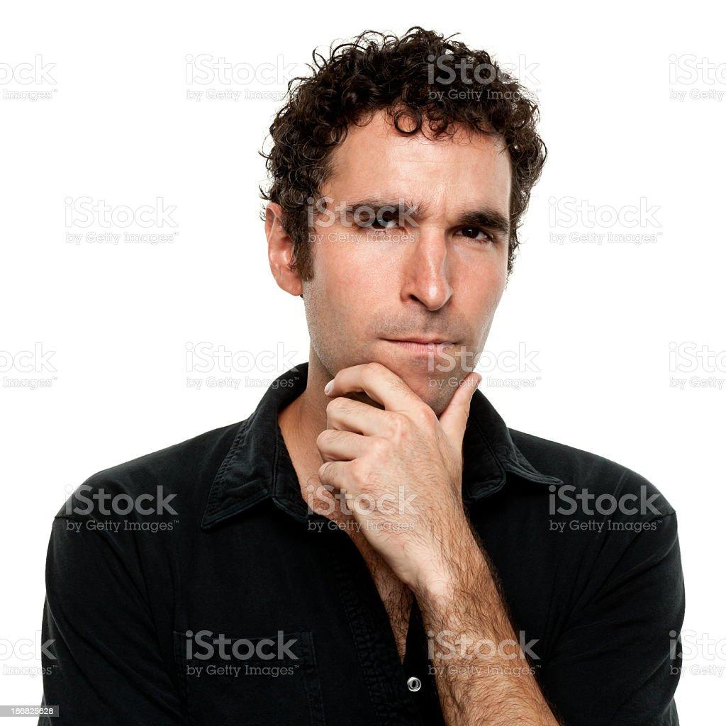 Frowning Dubious Man Stares At Camera stock photo