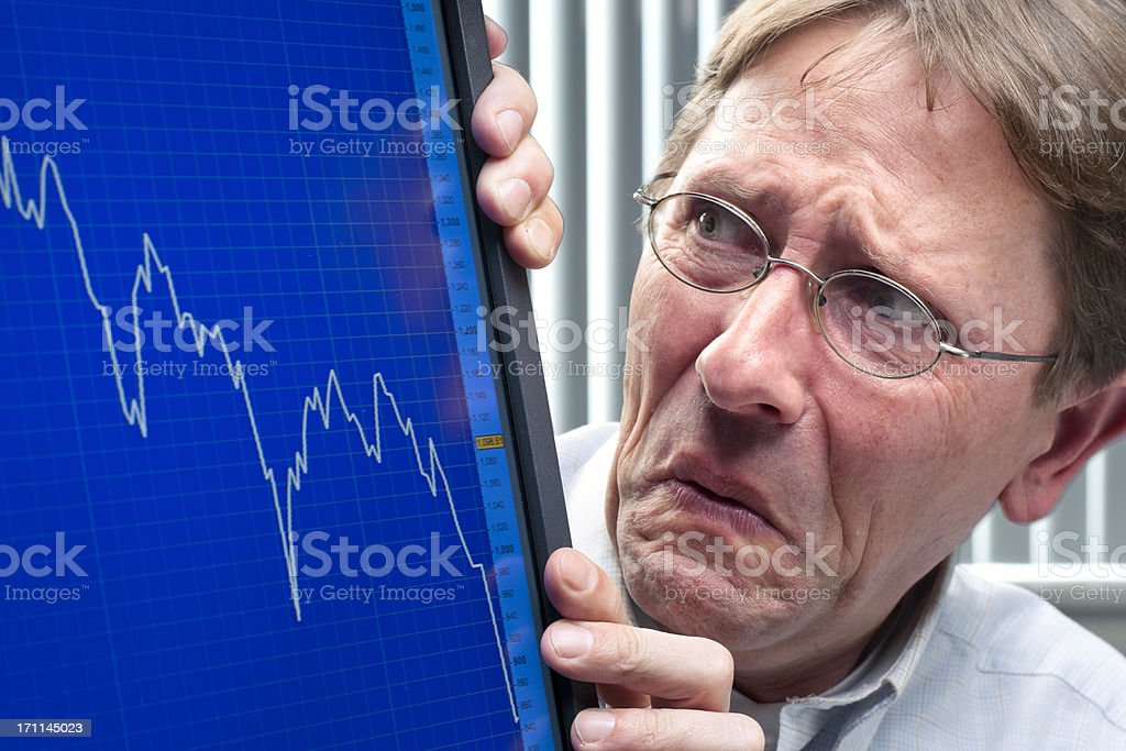 frowning man looking at stock exchange rate XXXL stock photo