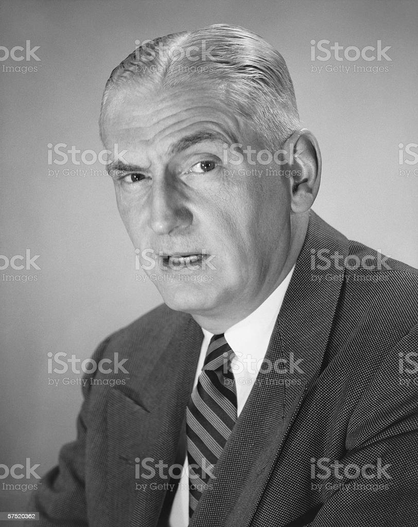 Frowning man posing in studio, (B&W), portrait royalty-free stock photo