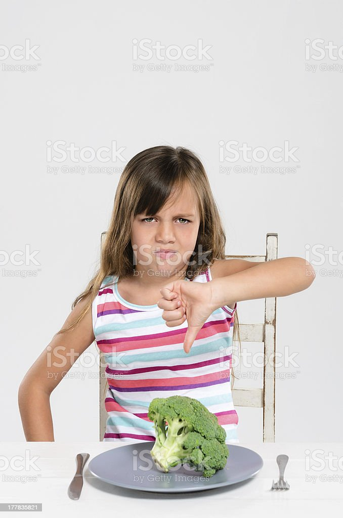 Frowning upset girl with her vegetables royalty-free stock photo