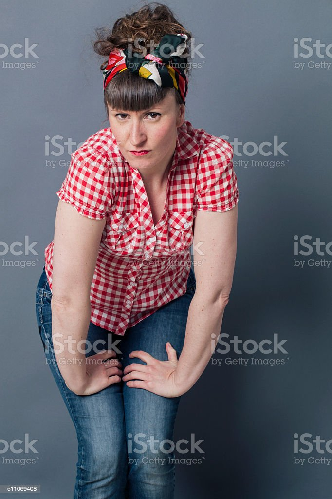 frowning young woman with retro hairstyle and fashion stock photo