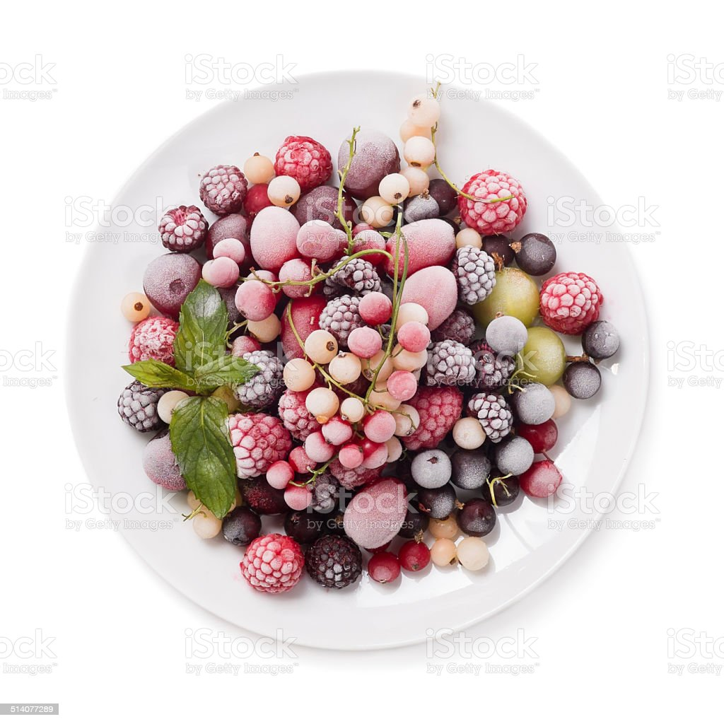 Frozen berry isolated on white background top view stock photo