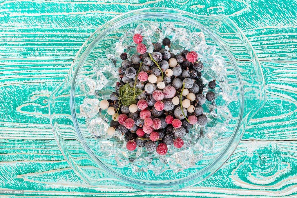 frozen black currant berries stock photo