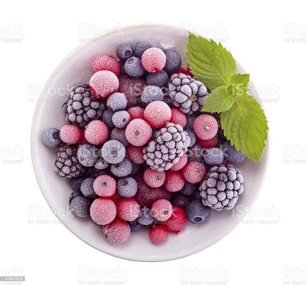 Frozen blackberries and blueberries with a mint garnish stock photo