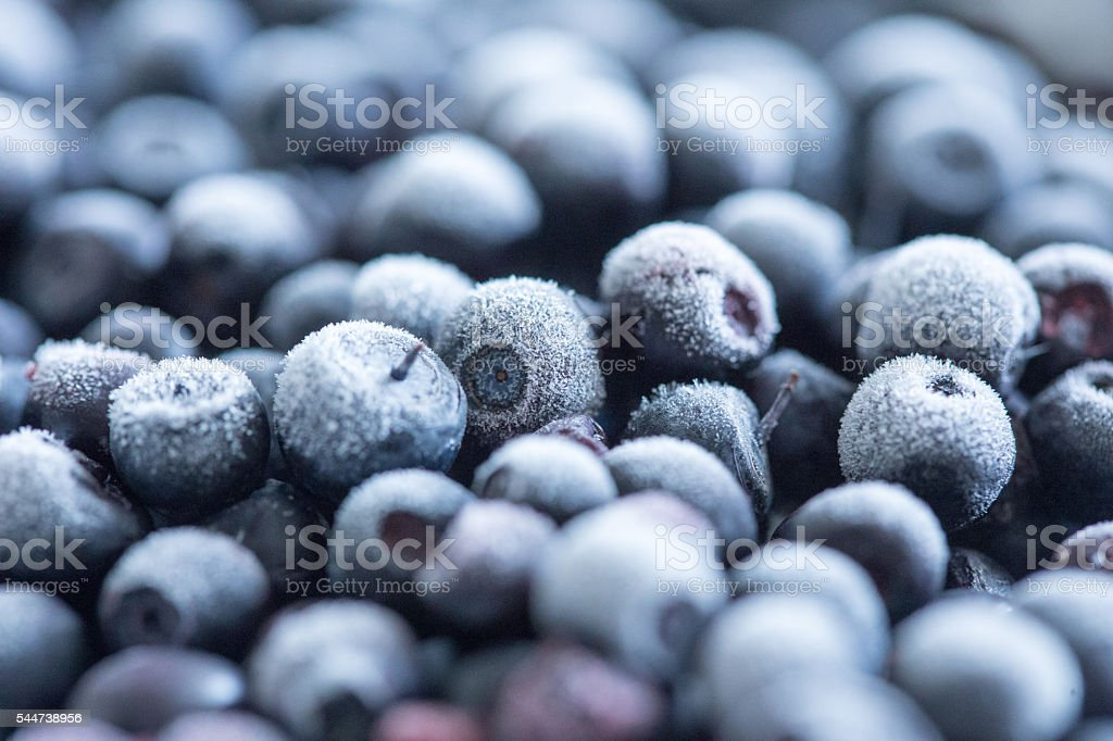 Frozen blueberries background stock photo