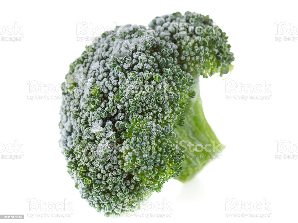 Frozen broccoli with ice crystals on white background stock photo