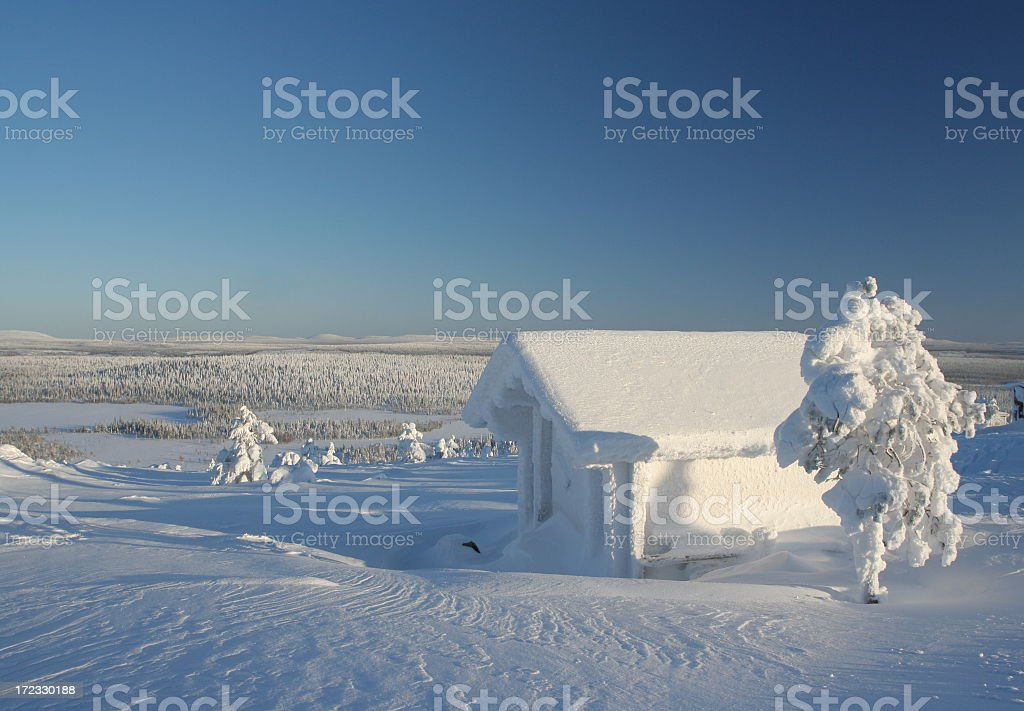 Frozen cabin with snow and trees royalty-free stock photo
