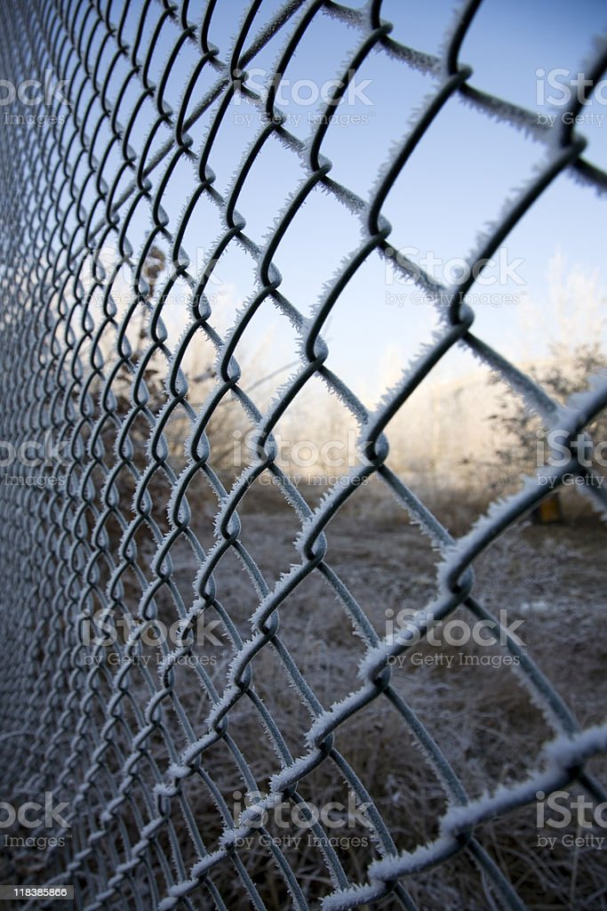 frozen chainlink fence stock photo