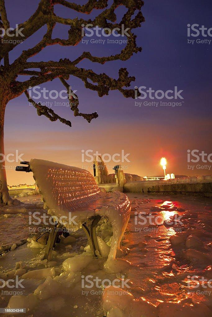 Frozen Chair beside Lake Geneva royalty-free stock photo
