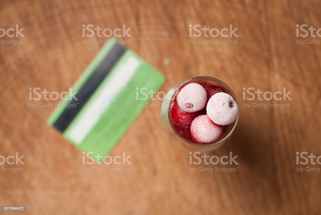 Frozen cherries in wine glass, stock photo
