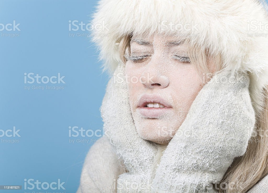 Frozen. Chilled female face covered in snow ice stock photo