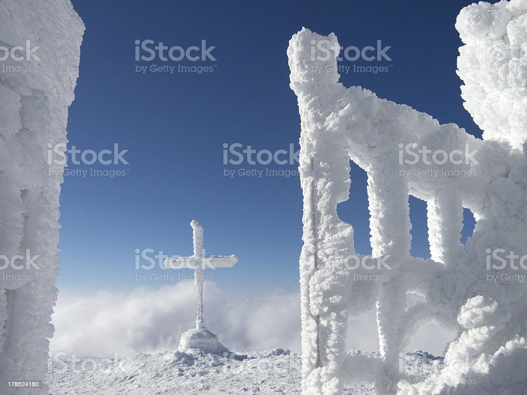 frozen cross in the mountain royalty-free stock photo