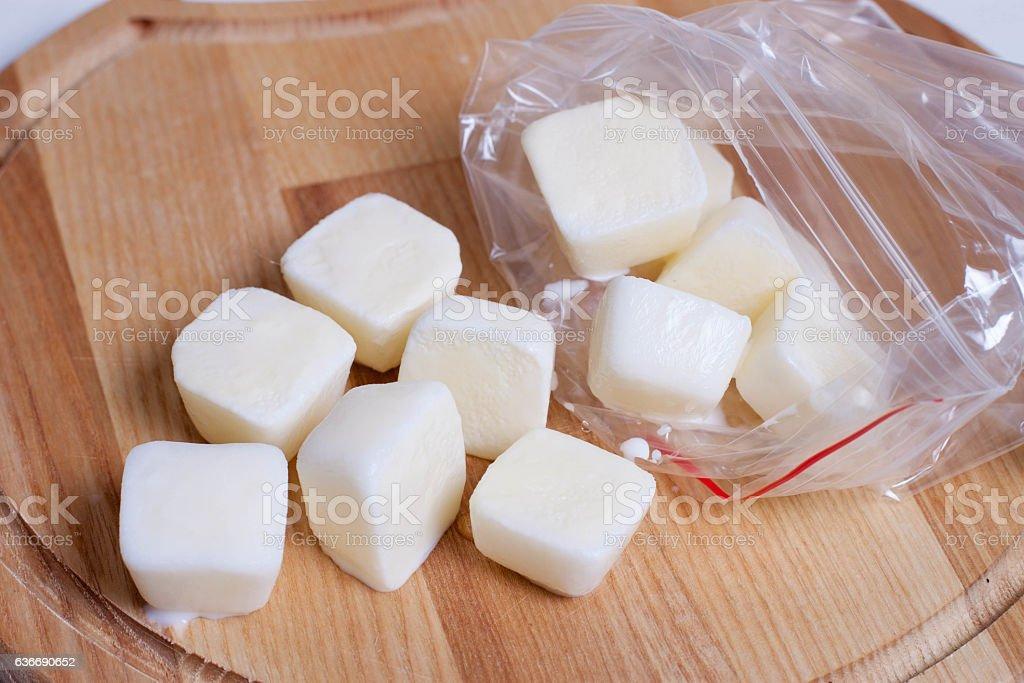Frozen cubes of milk stock photo