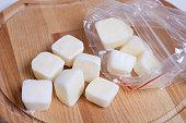Frozen cubes of milk