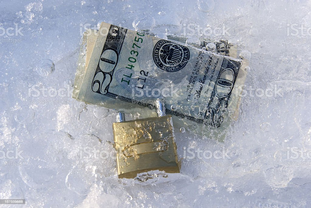Frozen dollars with padlock stock photo