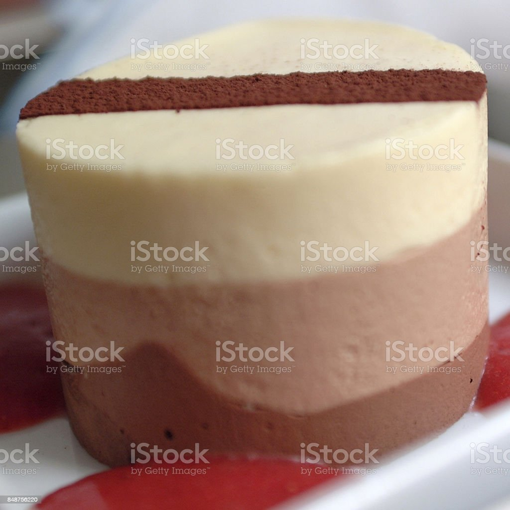 Frozen drop shaped cake with strawberries cake stock photo