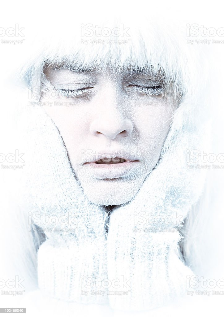 Frozen female face with eyes closed covered in frost royalty-free stock photo