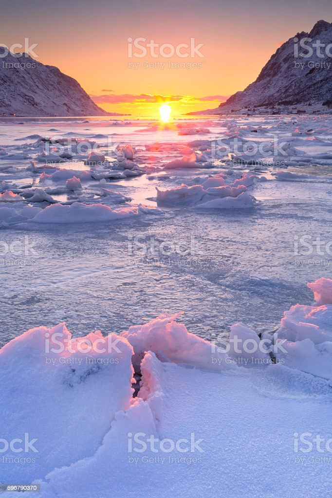 Frozen fjord in northern Norway in winter at sunrise stock photo