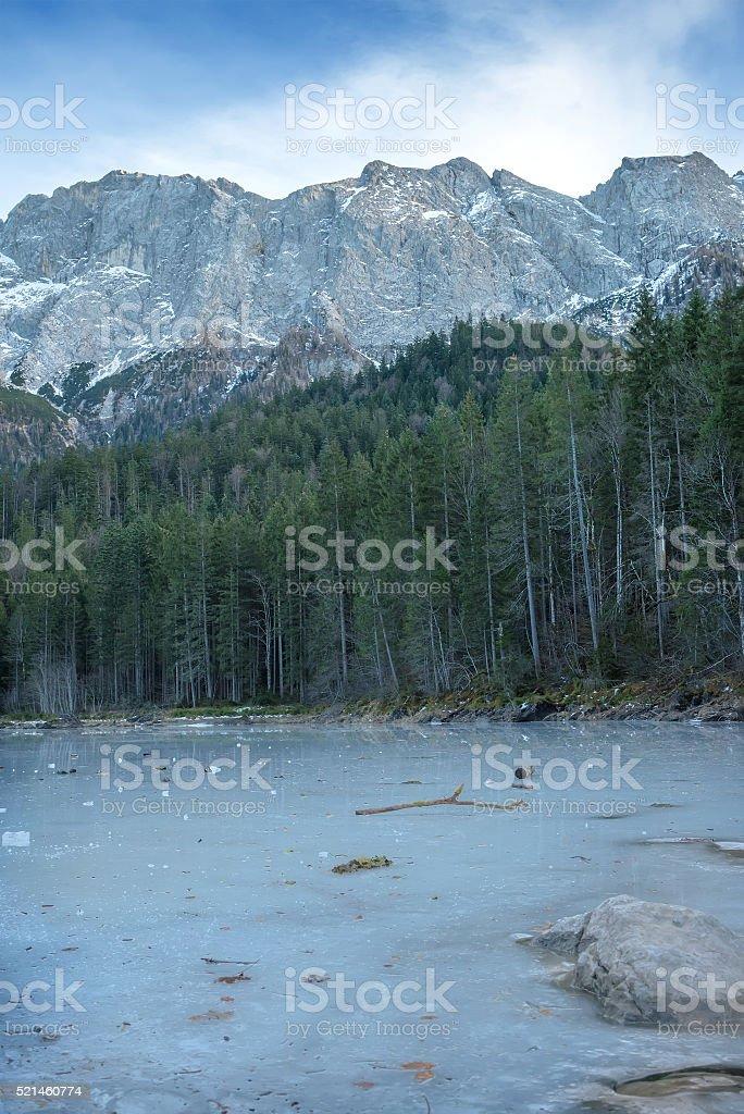 Frozen forest lake in Bavarian Alps near Eibsee lake, winter stock photo
