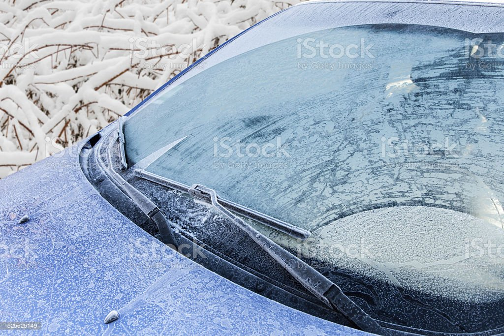 Frozen front windshield of car stock photo