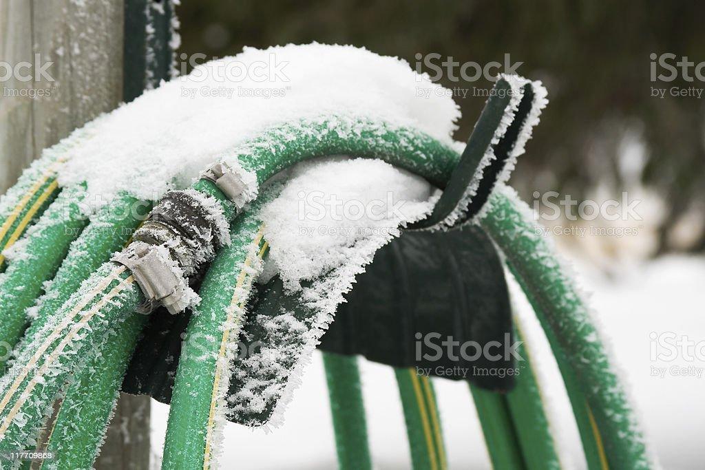 Frozen Garden Hose stock photo
