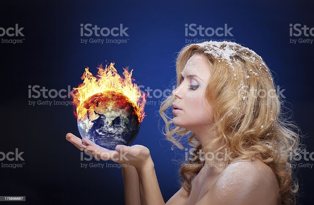 Frozen girl holding burning earth globe royalty-free stock photo
