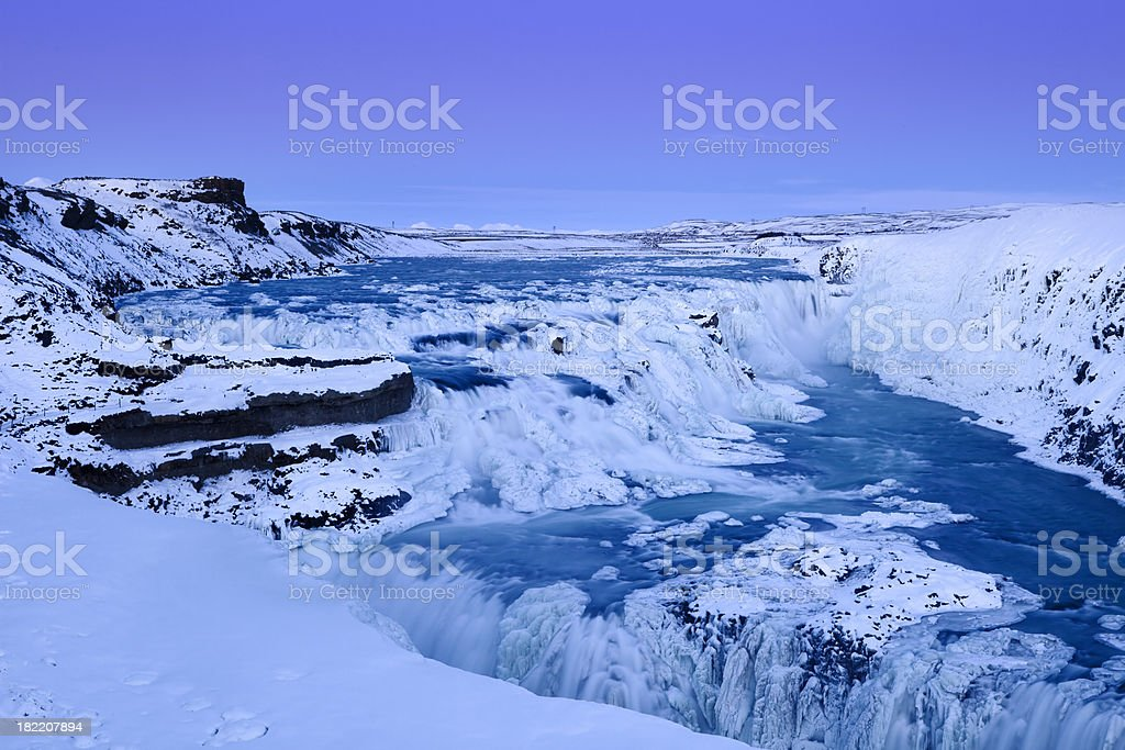 Frozen Gullfoss Falls in Iceland in winter at sunset royalty-free stock photo