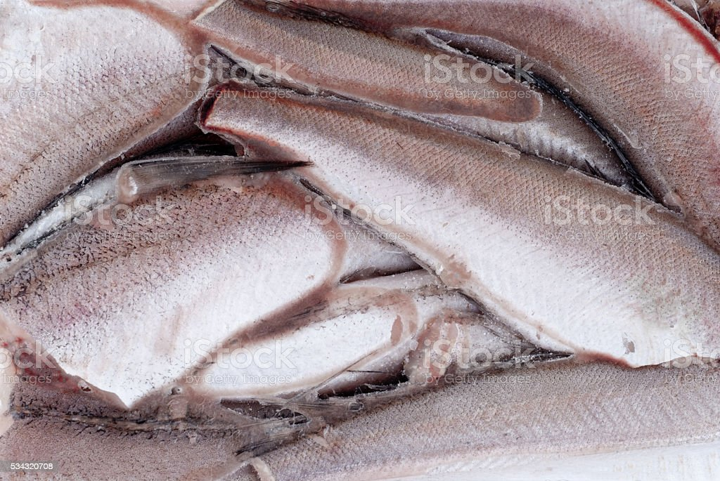 Frozen hake fish as food background stock photo