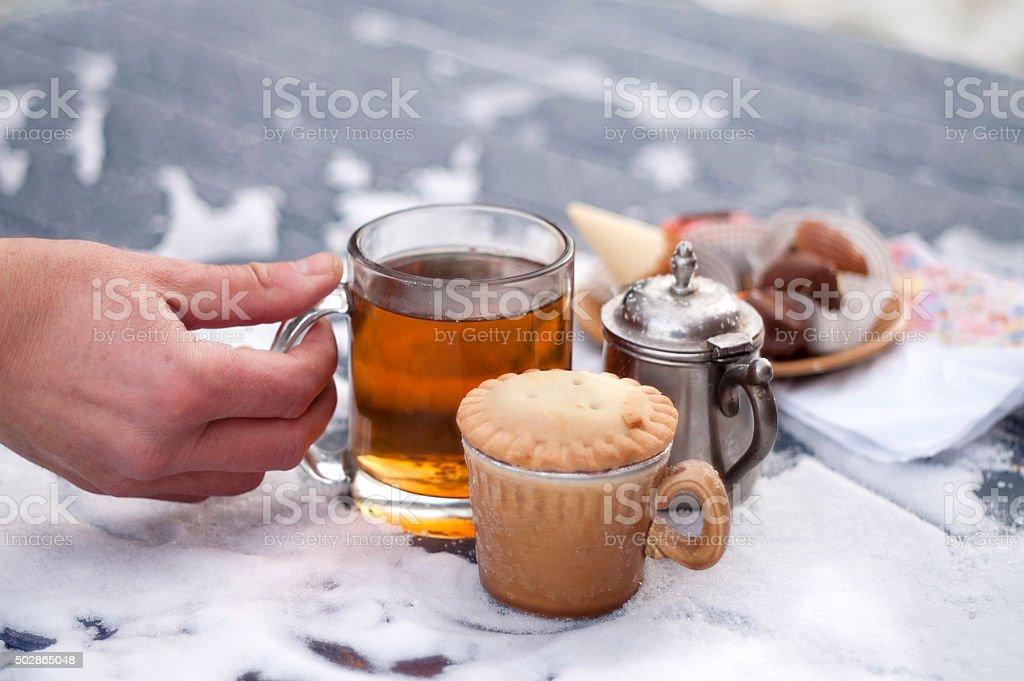 Frozen Hand With Tea stock photo