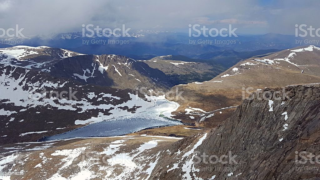 frozen high mountain lake from above stock photo