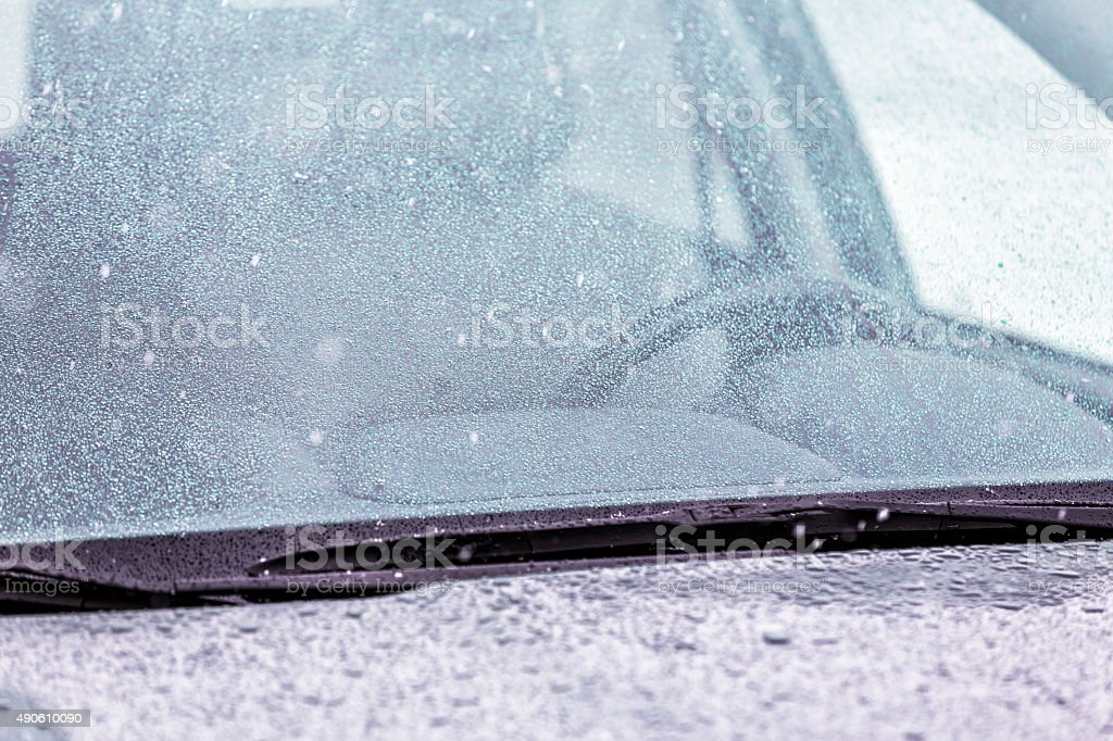 Frozen Ice and Rain Winter Car Windshield stock photo
