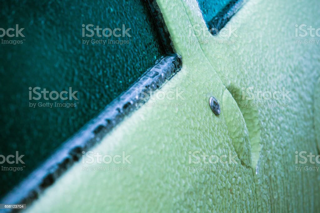 Frozen, ice-locked car door with icicles, ice and frost stock photo
