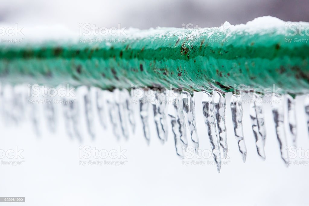 Frozen icy down pipe stock photo