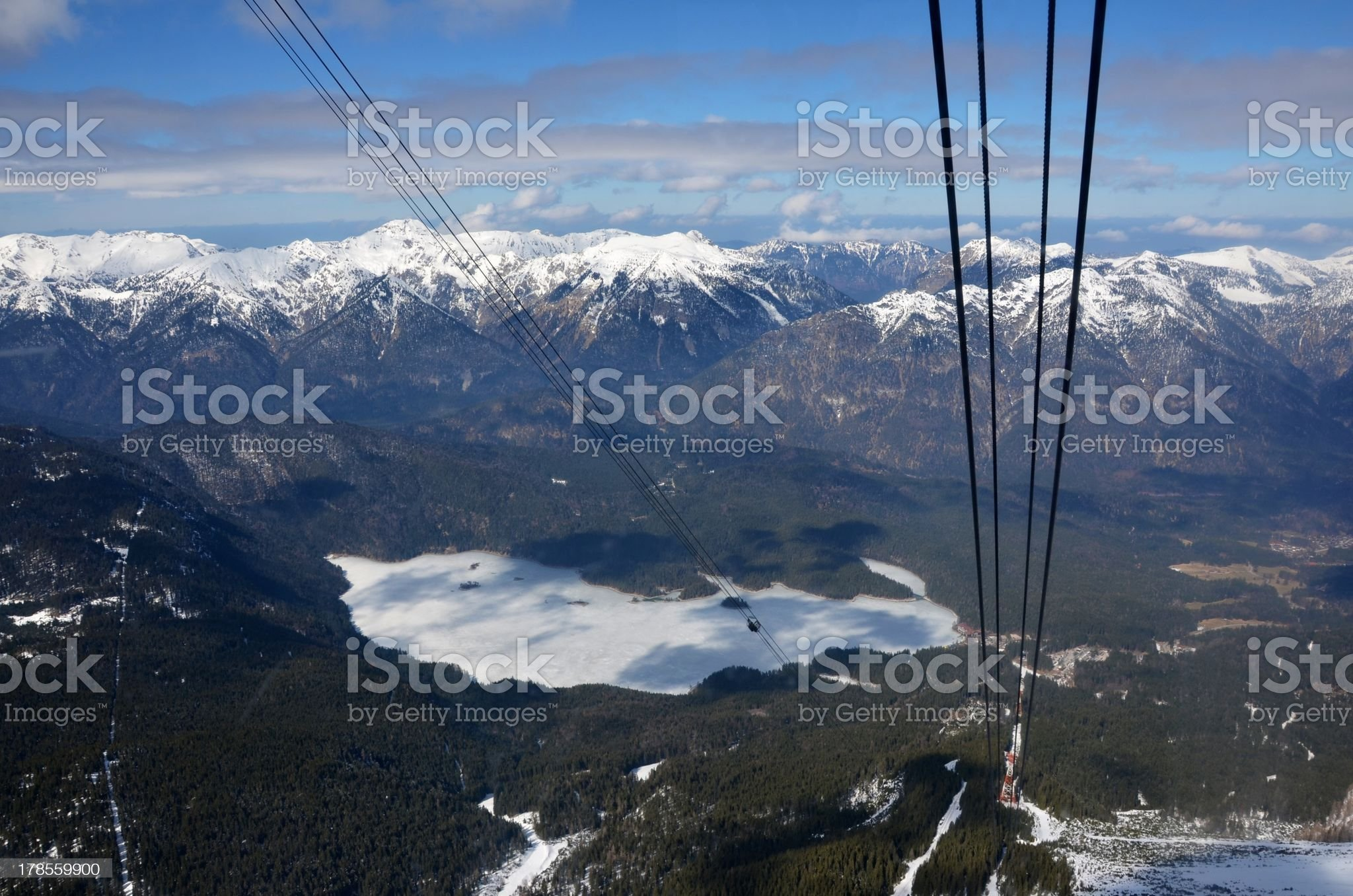 Frozen Lake and Snow-Capped Mountains in the Alps royalty-free stock photo