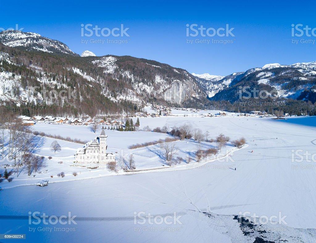Frozen Lake Grundlsee with Village Gössl, Totes Gebirge, Steiermark, Austria stock photo