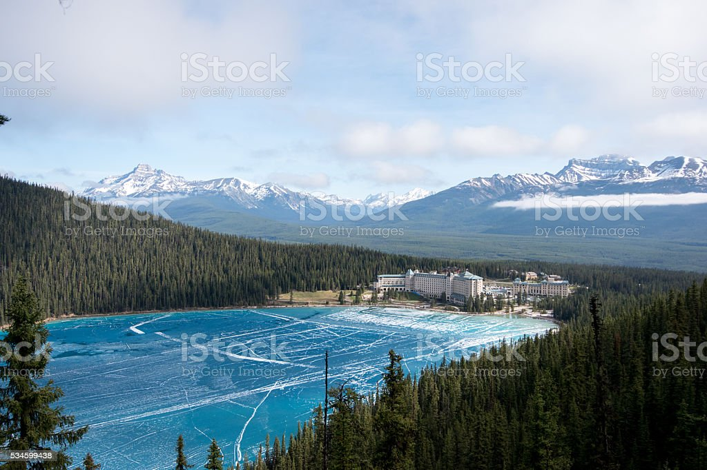 frozen lake louise and view on the hotel fairmont chateau stock photo