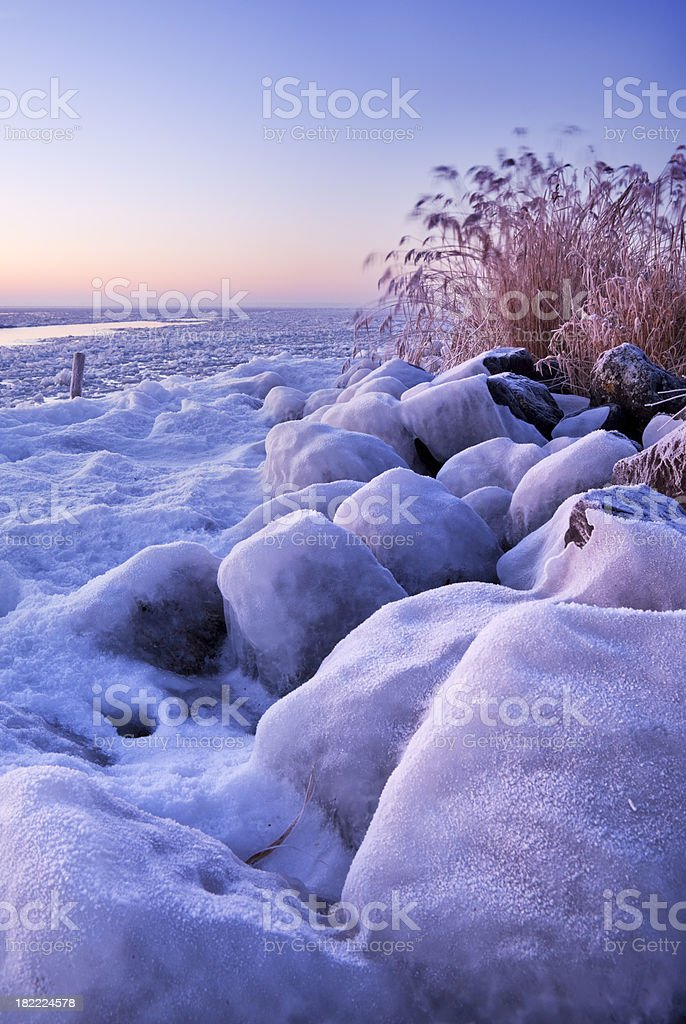 Frozen lake Markermeer, The Netherlands at sunrise royalty-free stock photo