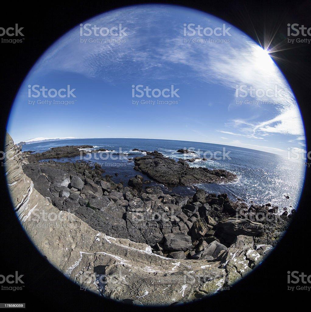 frozen lava on the Iceland Atlantic Ocean shore royalty-free stock photo