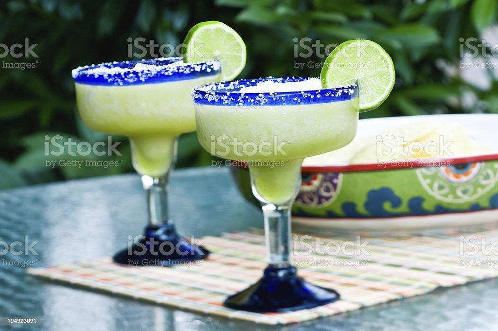 Frozen margaritas with lime as garnishing  stock photo