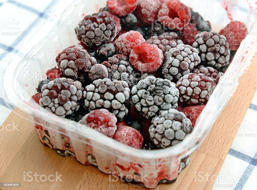 frozen mixed berries stock photo