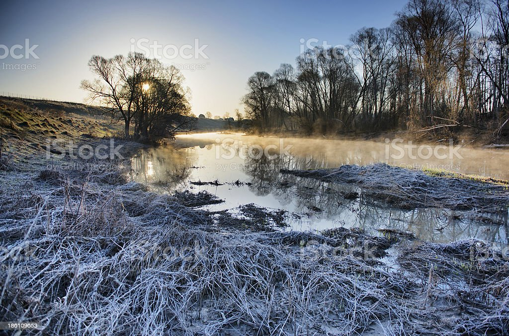 Frozen morning landscape with a river royalty-free stock photo