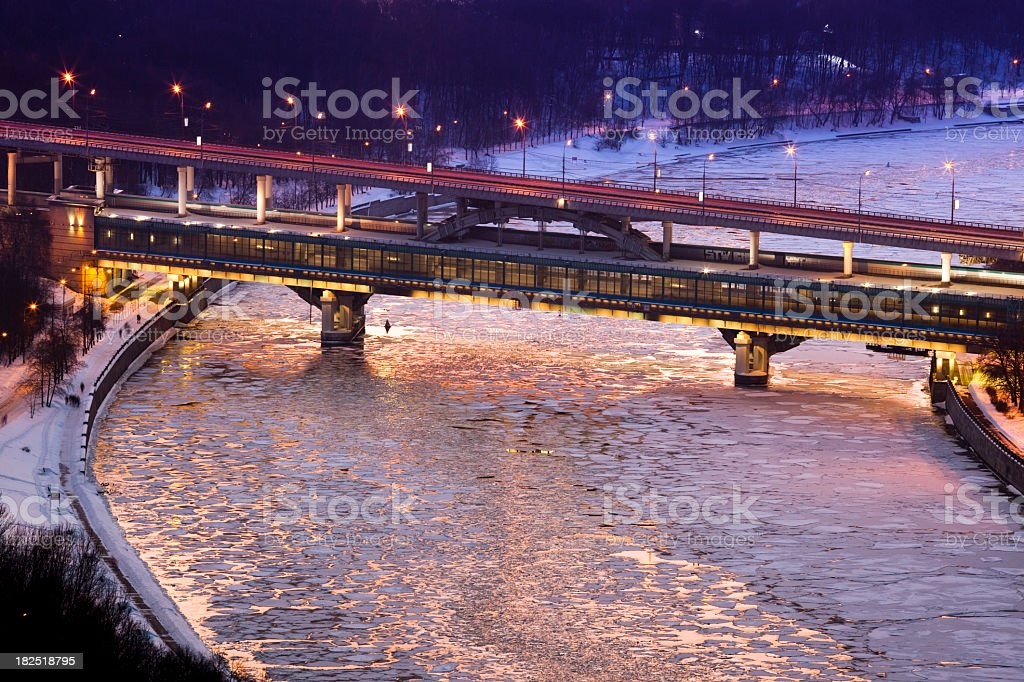 Frozen Moscow river and bridge at sunset royalty-free stock photo