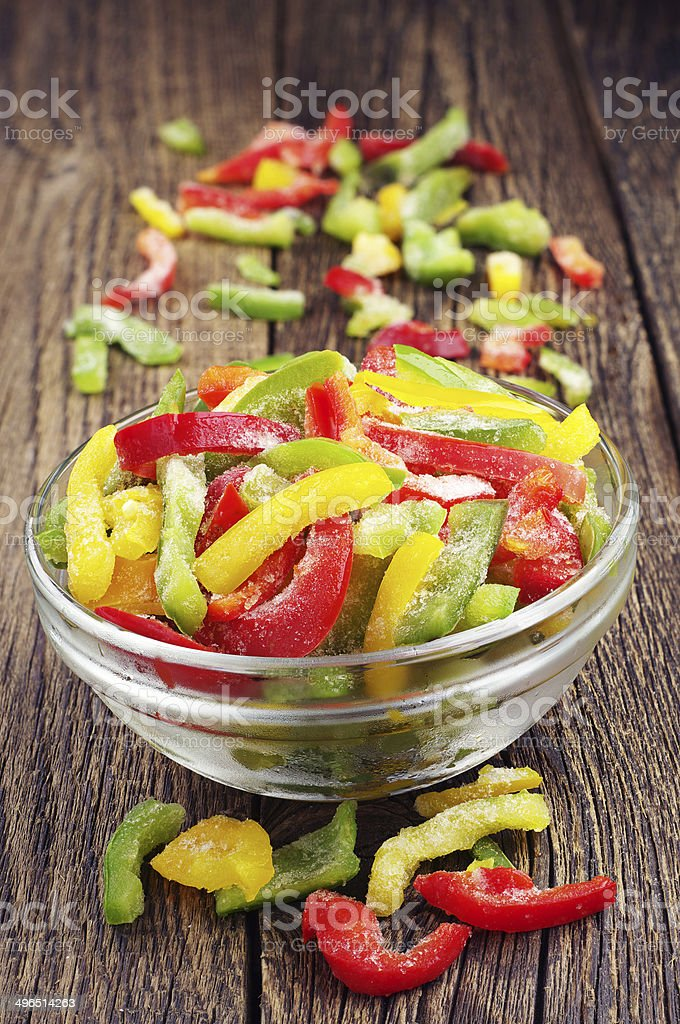 Frozen multicolored peppers stock photo