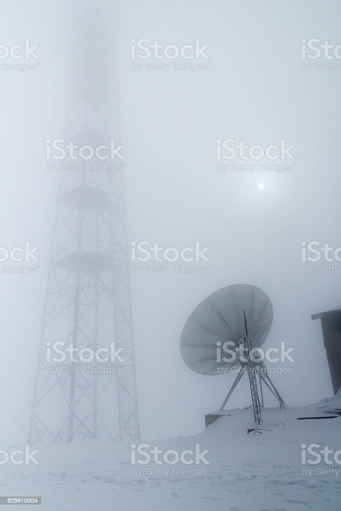 Frozen multiple purposes antenna satellite tower stock photo