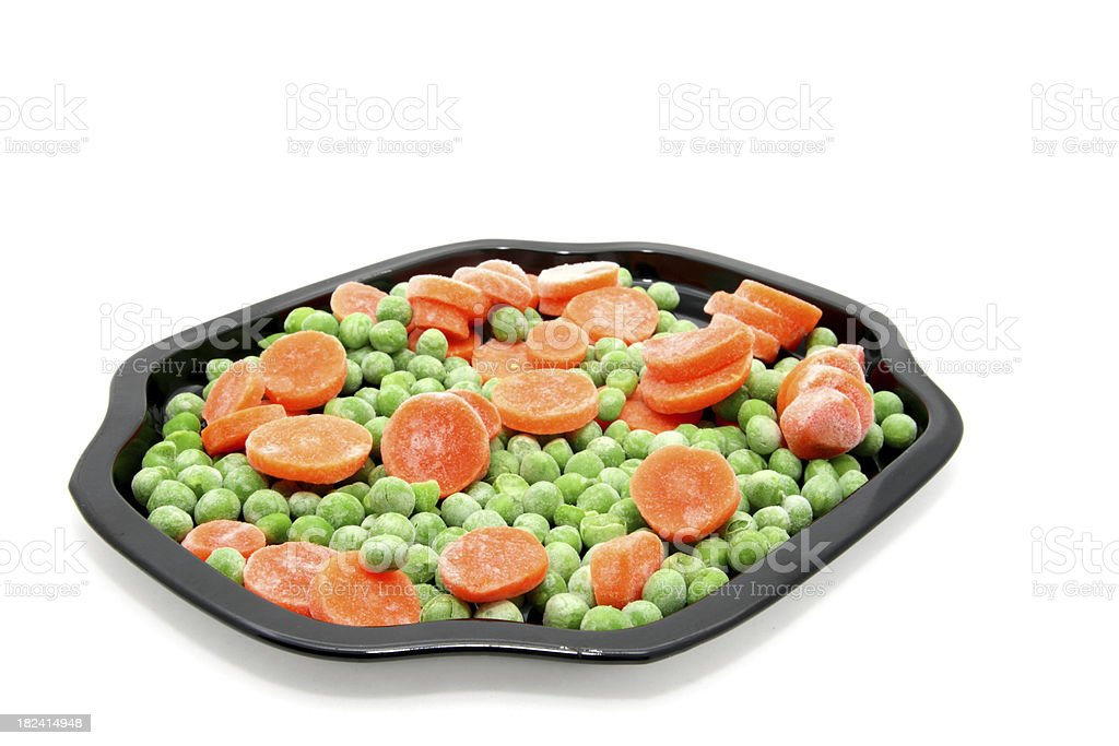 Frozen Peas and Carrots on Black Tray royalty-free stock photo